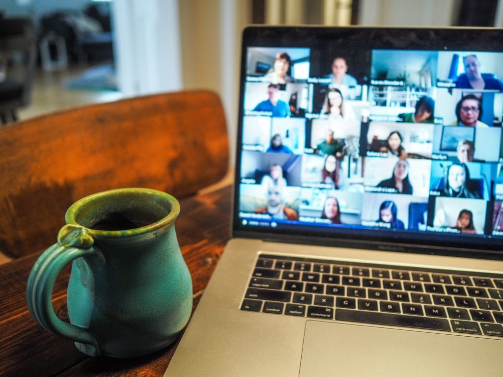 Image of participants of a virtual videoconference on a laptop.