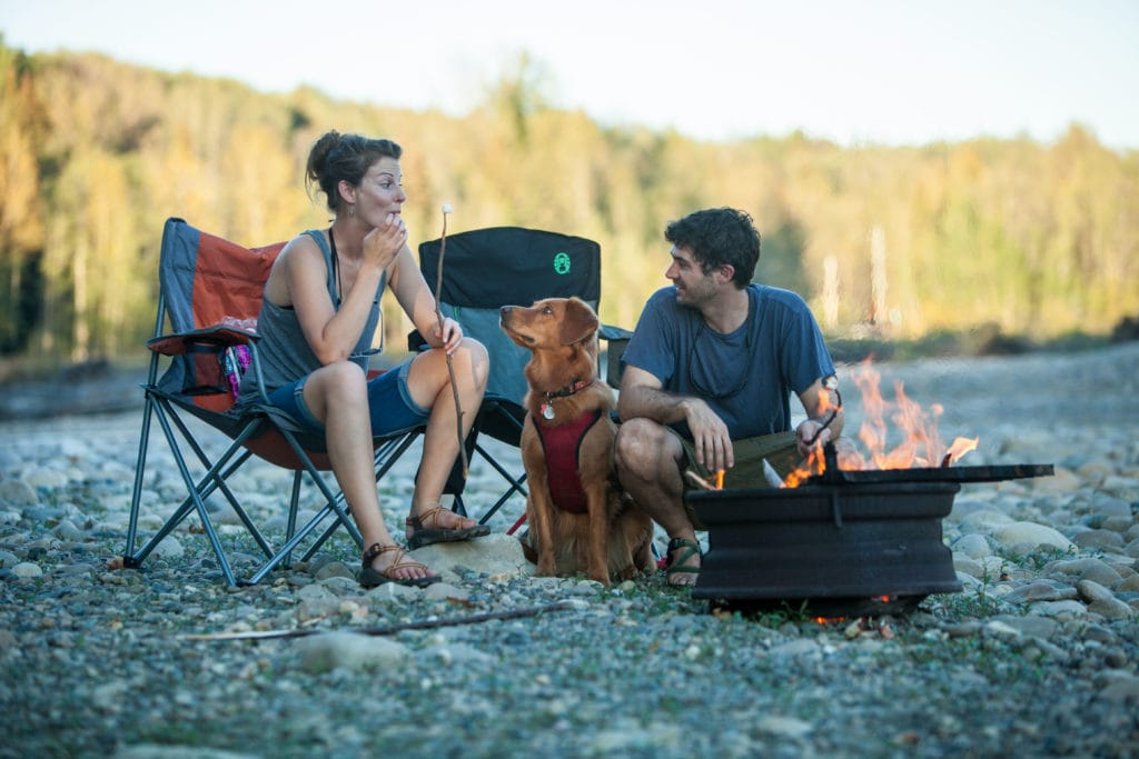 A couple and their dog enjoy the scenery at Salmon Valley Campground.