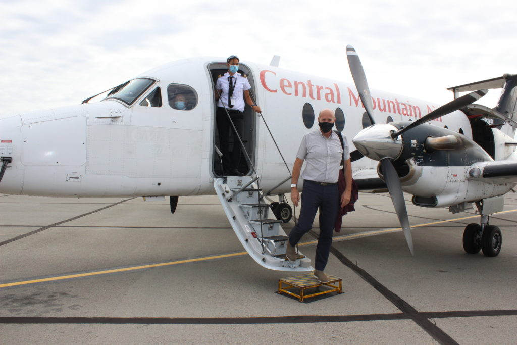 CEO of the Prince George Airport Authority Gordon Duke disembarks from a plane.